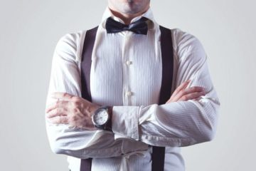 Male manager with bow tie and braces and folded arms