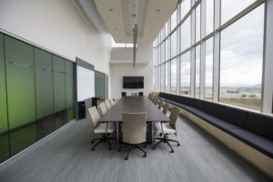 Office Space with conference desk and partition walls by fit-out contractors Glasgow